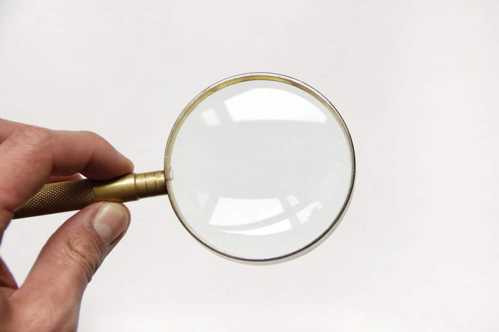 holding a magnify glass